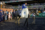 Essential Quality (2), with jockey Luis Saez up, is led through the winner's circle after winning the 153rd running of the Belmont Stakes horse race, Saturday, June 5, 2021, at Belmont Park in Elmont, N.Y. (AP Photo/John Minchillo)