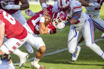 Temple quarterback Re-al Mitchell (13) is tackled by SMU defensive lineman Junior Aho (33) during the second half of an NCAA college football game, Saturday, Nov. 7, 2020, in Philadelphia. SMU won 47-23. (AP Photo/Laurence Kesterson)