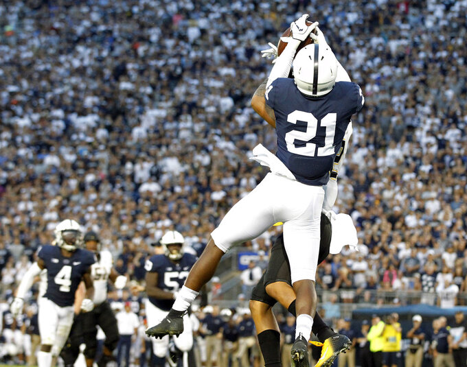 Penn State's Amani Oruwariye (21) intercepts a pass intended for Appalachian State's Corey Sutton (2) in the end zone during overtime of an NCAA college football game in State College, Pa., Saturday, Sept. 1, 2018. Penn State won 45-38 in OT. (AP Photo/Chris Knight)