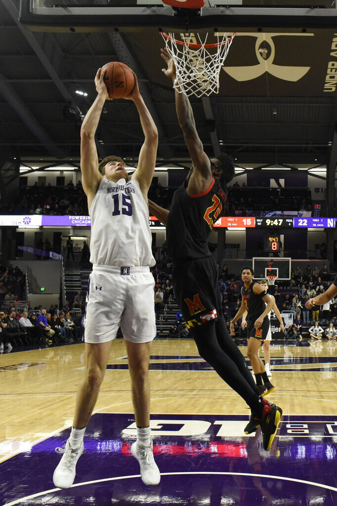 Maryland forward Jalen Smith (25) defends Northwestern center Ryan Young (15) during the first half of an NCAA college basketball game, Tuesday, Jan. 21, 2020, in Evanston, Ill. (AP Photo/David Banks)