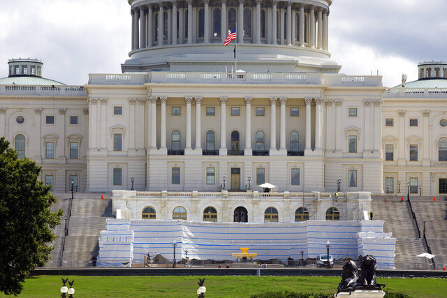 The West Front of the U.S. Capitol on Friday, Aug. 7, 2020, in Washington. While much of Washington is twisted in knots over the upcoming election, there's another contingent already busy trying to figure out how to stage an inauguration for the next president during a pandemic. (AP Photo/Jon Elswick)