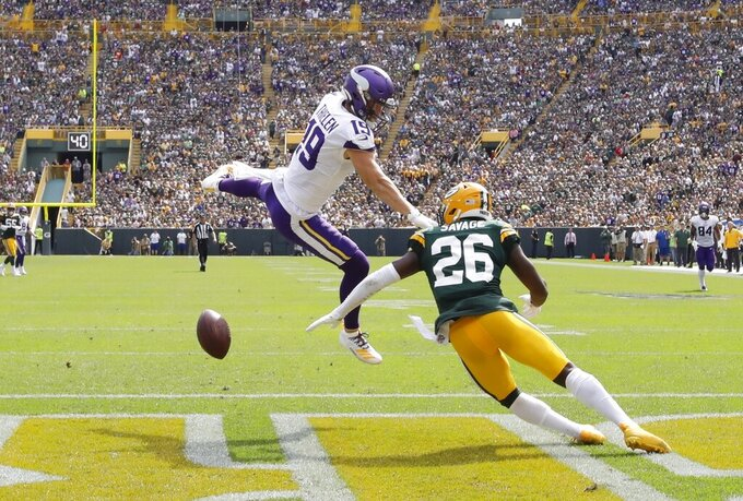 Minnesota Vikings' Adam Thielen is called for pass interference on a play against Green Bay Packers' Darnell Savage during the second half of an NFL football game Sunday, Sept. 15, 2019, in Green Bay, Wis. (AP Photo/Mike Roemer)
