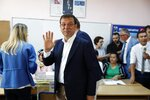 Ekrem Imamoglu, candidate of the secular opposition Republican People's Party, or CHP waves to the media at a polling station in Istanbul, Sunday, June 23, 2019. Voters in Istanbul returned to the polls Sunday for a re-run mayoral election ordered up by authorities after President Recep Tayyip Erdogan and his political allies lost control of Turkey's largest city for the first time in 25 years. (AP Photo/Lefteris Pitarakis)