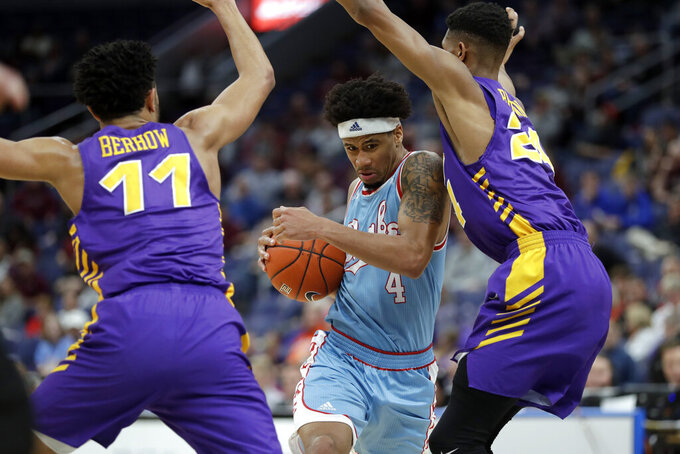 Drake's Anthony Murphy (4) heads to the basket past Northern Iowa's Trae Berhow (11) and Isaiah Brown during the first half of an NCAA college basketball game in the semifinal round of the Missouri Valley Conference tournament, Saturday, March 9, 2019, in St. Louis. (AP Photo/Jeff Roberson)