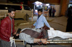An injured victim of mosque bombing, is brought to hospital in Quetta, Pakistan, Friday, Jan. 10, 2020. A powerful explosion ripped through a mosque in southwest Pakistan during Friday evening prayers, killing a senior police officer with some civilians and wounded other worshipers, police said. (AP Photo/Arshad Butt)