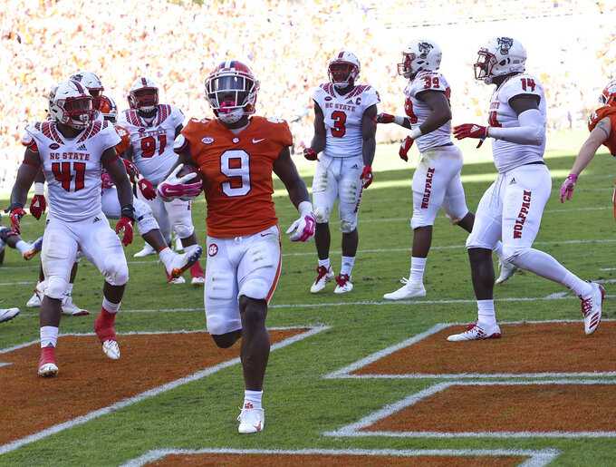 Clemson's Travis Etienne scores a touchdown during the first half of an NCAA college football game against North Carolina State, Saturday, Oct. 20, 2018, in Clemson, S.C. (AP Photo/Richard Shiro)