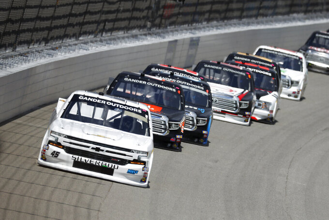Ross Chastain leads the field during a NASCAR Truck Series race at Michigan International Speedway in Brooklyn, Mich., Saturday, Aug. 10, 2019. (AP Photo/Paul Sancya)