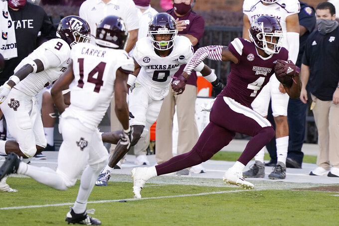 Mississippi State wide receiver Malik Heath (4) evades a host of Texas A&M defenders on his way to a 32-yard touchdown pass reception during the second half of an NCAA college football game in Starkville, Miss., Saturday, Oct. 17, 2020. (AP Photo/Rogelio V. Solis)