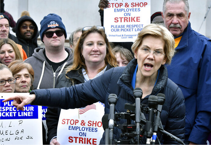 Democratic Presidential hopeful, Sen. Elizabeth Warren, D-Mass., speaks after she joined striking Stop & Shop supermarket employees on the picket line on Friday, April 12, 2019, in Somerville, Mass. Unionized workers in three states walked off the job on Thursday over stalled contract negotiations. (AP Photo/Josh Reynolds)