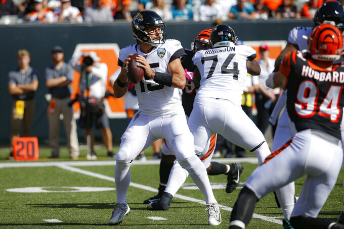 Jacksonville Jaguars quarterback Gardner Minshew (15) looks to pass in the first half of an NFL football game against the Cincinnati Bengals, Sunday, Oct. 20, 2019, in Cincinnati. (AP Photo/Frank Victores)