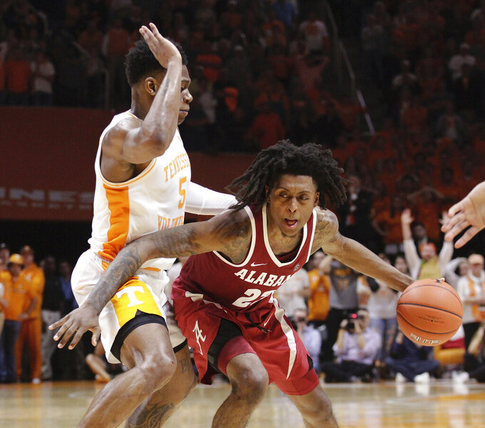 Alabama guard John Petty (23) drives the ball against Tennessee guard Admiral Schofield (5) in the second half of an NCAA college basketball game, Saturday, Jan. 19, 2019, in Knoxville, Tenn. Tennessee won 71-68 (AP Photo/Shawn Millsaps)