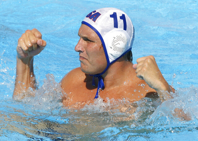 FILE - In this July 28, 2009, file photo, Jesse Smith, of the United States, reacts during a waterpolo quarterfinal match against Germany at the FINA Swimming World Championships in Rome. One way Smith is dealing with the coronavirus pandemic is through virtual speaking engagements with water polo clubs and teams all over the country, passing along what he has learned during a couple decades in the water. (AP Photo/Alessandra Tarantino, File)