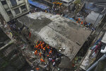 Rescuers look for survivors after a residential building collapsed in Bhiwandi in Thane district, a suburb of Mumbai, India, Monday, Sept.21, 2020. (AP Photo/Praful Gangurde)