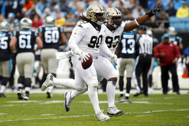 New Orleans Saints defensive tackle Malcom Brown (90) and defensive tackle David Onyemata (93) celebrate Brown's fumble recovery against the Carolina Panthers during the first half of an NFL football game in Charlotte, N.C., Sunday, Dec. 29, 2019. (AP Photo/Brian Blanco)