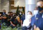 Houston Police officers watch as chief Art Acevedo talks to reporters about the death of Sgt. Harold Preston, at Memorial Hermann Hospital on Tuesday, Oct. 20, 2020, in Houston. Two officers were shot by a suspect during a domestic violence call at an apartment complex. (Godofredo A. Vásquez/Houston Chronicle via AP)