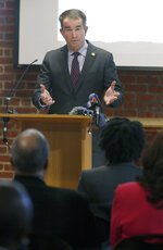 Gov. Ralph Northam addresses a gathering after receiving the report from The Commission to Examine Racial Inequity in Virginia Law in Richmond, Va., Thursday, Dec. 5, 2019. (Bob Brown/Richmond Times-Dispatch via AP)