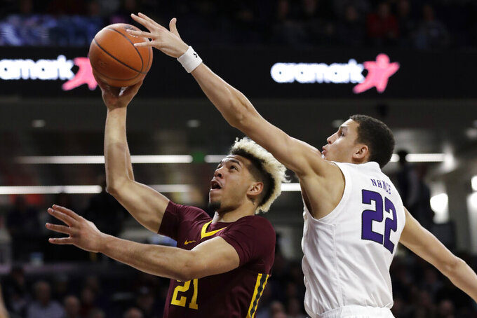 Minnesota forward Jarvis Omersa, left, shoots against Northwestern forward Pete Nance during the first half of an NCAA college basketball game in Evanston, Ill., Sunday, Feb. 23, 2020. (AP Photo/Nam Y. Huh)