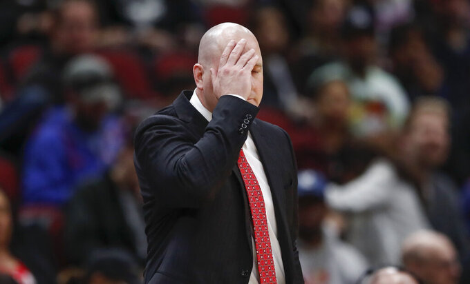 FILE - In this Tuesday, April 9, 2019, file photo, Chicago Bulls head coach Jim Boylen reacts during the second half of an NBA basketball game against the New York Knicks, in Chicago. The Chicago Bulls fired coach Jim Boylen on Friday, Aug. 14, 2020, as the new front office begins its remake of a team that missed the playoffs again.(AP Photo/Kamil Krzaczynski, File)