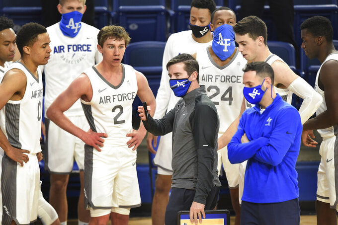 Air Force coach Joe Scott talks to his team during a timeout in the second half of an NCAA college basketball game against Utah State on Thursday, Dec. 31, 2020, at Air Force Academy, Colo. (Jerilee Bennett/The Gazette via AP)