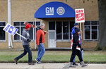 General Motors employees picket outside the General Motors Fabrication Division, Wednesday, Oct. 16, 2019, in Parma, Ohio. Bargainers for General Motors and the United Auto Workers reached a tentative contract deal on Wednesday that could end a monthlong strike that brought the company's U.S. factories to a standstill. (AP Photo/Tony Dejak)