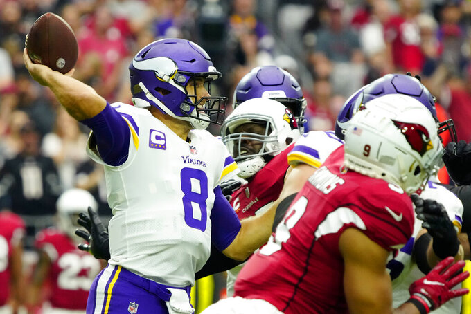 Minnesota Vikings quarterback Kirk Cousins (8) throws against the Arizona Cardinals during the first half of an NFL football game, Sunday, Sept. 19, 2021, in Glendale, Ariz. (AP Photo/Rick Scuteri)