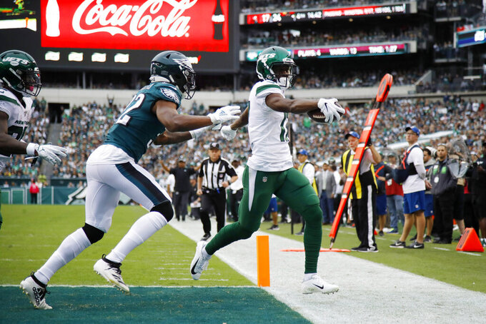 New York Jets' Vyncint Smith, right, scores a touchdown against Philadelphia Eagles' Rasul Douglas during the second half of an NFL football game, Sunday, Oct. 6, 2019, in Philadelphia. (AP Photo/Matt Rourke)