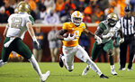 Tennessee running back Ty Chandler (8) runs for yardage as he's chased by UAB linebacker Fitzgerald Mofor (52) and safety Grayson Cash (12) in the first half of an NCAA college football game Saturday, Nov. 2, 2019, in Knoxville, Tenn. (AP Photo/Wade Payne)