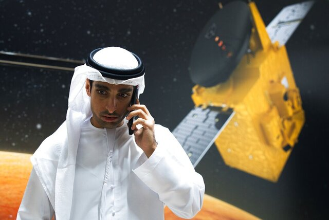 Omran Sharaf, the project director for the Emirates' Hope space probe to Mars, speaks on his mobile phone at the Mohammed bin Rashid Space Center in Dubai, United Arab Emirates, Sunday, July 19, 2020. A Japanese H-IIA rocket carrying a United Arab Emirates Mars spacecraft has been placed on the launch pad for Monday's scheduled liftoff for the Arab world's first interplanetary mission, officials said Sunday. (AP Photo/Jon Gambrell)