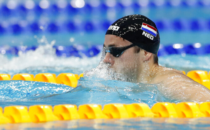 FILE - In this May 19, 2021, file photo, Arno Kamminga, of the Netherlands, competes during the men's 200-meters breaststroke preliminaries at the European Aquatics Championships in Duna Arena in Budapest, Hungary. Kamminga says he has the tactics to beat the most heavily favored swimmer at the Olympics: Adam Peaty. In May, Kamminga became the only man besides Peaty to break the 58-second barrier when he clocked 57.90 at the Dutch trials. (AP Photo/Petr David Josek, File)