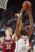 Southern California forward Isaiah Mobley, right, wins a rebound over Stanford forward Lukas Kisunas during the first half of an NCAA college basketball game Wednesday, March 3, 2021 in Los Angeles. (AP Photo/Kyusung Gong)