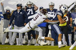 Texas State wide receiver Drue Jackson (9) reachers for BYU linebacker Isaiah Kaufusi (53) after he makes an interception in the second half during an NCAA college football game Saturday, Oct. 24, 2020, in Provo, Utah. (AP Photo/Rick Bowmer)