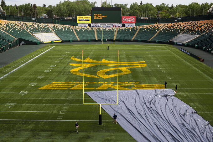 The Edmonton Elks Canadian Football League new name and logo are unveiled at Commonwealth Stadium in Edmonton, Alberta, Tuesday, June 1, 2021. The Edmonton CFL franchise has changed its team name to Elks. Edmonton dropped its longtime name, Eskimos, last year following a similar decision by the NFL's Washington team amid pressure on franchises to eliminate racist or stereotypical names. (Jason Franson/The Canadian Press via AP)