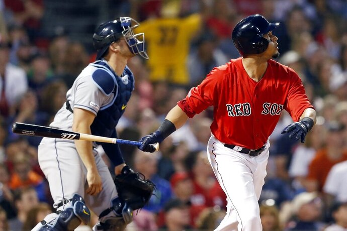 Boston Red Sox's Marco Hernandez, right, watches his two-run double in front of Tampa Bay Rays' Mike Zunino during the sixth inning of the second game of a baseball doubleheader in Boston, Saturday, June 8, 2019. (AP Photo/Michael Dwyer)
