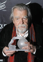 FILE - In this Feb.7, 2011 file photo, actor Michael Lonsdale poses after receiving a Crystal Globe award of best actor during the Crystal Globes awards ceremony, in Paris. Michael Lonsdale, a French-British actor and giant of the silver screen and theatre in France, died on Monday, his agent said. From his role as villain in the 1979 James Bond film