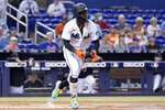 Miami Marlins' Jazz Chisholm Jr. runs after hitting a single during the first inning of a baseball game against the New York Mets, Thursday, Aug. 5, 2021, in Miami. (AP Photo/Lynne Sladky)