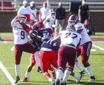 Massachusetts quarterback Garrett Dzuro (9) makes a pass under pressure during the first half of an NCAA college football game against Liberty on Friday, Nov. 27, 2020, at Williams Stadium in Lynchburg, Va. (AP Photo/Shaban Athuman)