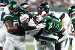 New York Jets' Bryce Hall (37) and Foley Fatukasi (94) tackles Philadelphia Eagles' Kenneth Gainwell (14) during the first half of an NFL preseason football game Friday, Aug. 27, 2021, in East Rutherford, N.J. Unnecessary penalty was called on Hall on the play. (AP Photo/Noah K. Murray)