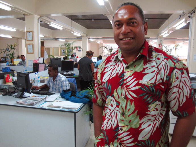 In this Nov. 6, 2013 photo, Fiji Times newspaper editor Fred Wesley stands in the newsroom in Suva, Fiji. Wesley was sentenced to six months in jail, suspended for two years, for reprinting an article from a New Zealand newspaper that said Fiji's judiciary is not independent. An opinion writer and three newspaper executives in Fiji are awaiting a judge's verdict Friday, May 18, 2018, on sedition charges in a case that has major implications for press freedom in the South Pacific nation. (AP Photo/Nick Perry)