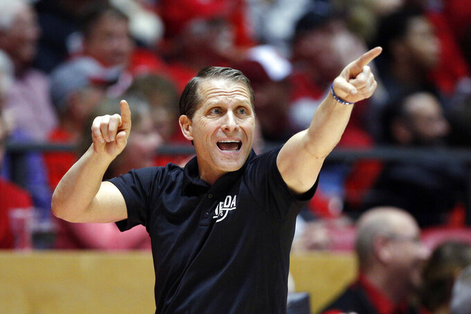 FILE - In this Jan. 5, 2019, file photo, Nevada coach Eric Musselman gives instructions to his players from the sideline during the second half of the team's NCAA college basketball game against New Mexico in Albuquerque, N.M. Arkansas has hired Musselman as its next men's basketball coach. Razorbacks athletic director Hunter Yurachek announced Musselman's hiring Sunday, April 7, on Twitter. (AP Photo/Andres Leighton, File)