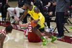 Oregon forward Eugene Omoruyi (2) dribbles past Stanford forward Lukas Kisunas (32) during the second half of an NCAA college basketball game in Stanford, Calif., Thursday, Feb. 25, 2021. (AP Photo/Jeff Chiu)