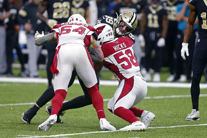 New Orleans Saints tight end Josh Hill (89) is stopped by Arizona Cardinals linebacker Cassius Marsh (54) and middle linebacker Jordan Hicks (58) in the first half of an NFL football game in New Orleans, Sunday, Oct. 27, 2019. (AP Photo/Butch Dill)