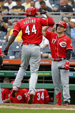 Cincinnati Reds' Aristides Aquino (44) celebrates with Josh VanMeter after hitting a solo home run off Pittsburgh Pirates starting pitcher Trevor Williams during the second inning of a baseball game in Pittsburgh, Sunday, Sept. 29, 2019. (AP Photo/Gene J. Puskar)