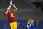 Southern California wide receiver Amon-Ra St. Brown, left, catches a pass while defended by UCLA defensive back Jay Shaw during the first quarter of an NCAA college football game Saturday, Dec 12, 2020, in Pasadena, Calif. (AP Photo/Ashley Landis)