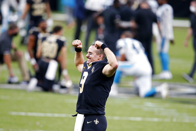 New Orleans Saints quarterback Drew Brees (9) reacts to the crowd after defeating the Carolina Panthers in a NFL football game in New Orleans, Sunday, Oct. 25, 2020. The Saints won 27-24. (AP Photo/Butch Dill)