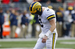 Michigan quarterback Shea Patterson reacts to throwing an incomplete pass against Ohio State during the second half of an NCAA college football game Saturday, Nov. 24, 2018, in Columbus, Ohio. Ohio State beat Michigan 62-39. (AP Photo/Jay LaPrete)