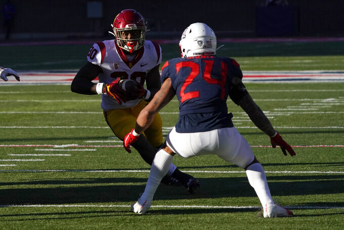 Southern California running back Markese Stepp (30) runs for a first down in front of Arizona defensive back Rhedi Short (24) in the second half during an NCAA college football game, Saturday, Nov. 14, 2020, in Tucson, Ariz. (AP Photo/Rick Scuteri)