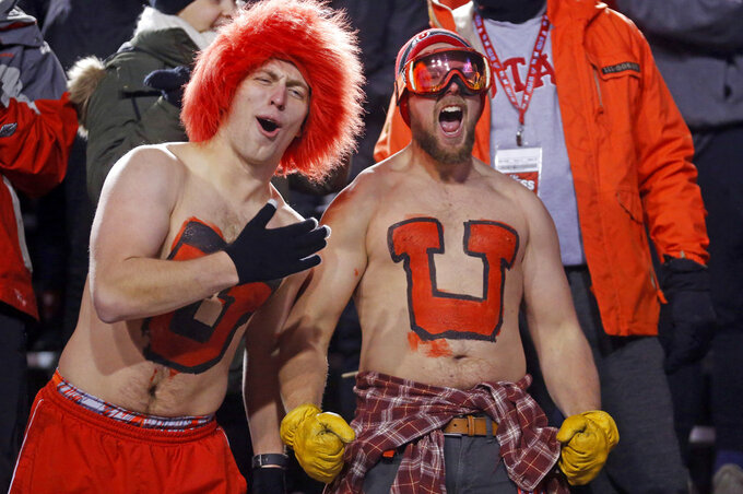 Utah fans show their support in the first half during an NCAA college football game against BYU Saturday Nov. 24, 2018, in Salt Lake City. (AP Photo/Rick Bowmer)