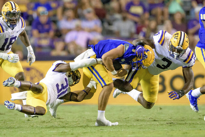McNeese State quarterback Cody Orgeron (8) is sacked by LSU safety Cameron Lewis (31) and defensive end Andre Anthony (3) during an NCAA college football game in Baton Rouge, La., Saturday, Sept. 11, 2021. Cody Orgeron was sacked eight times in the game. (AP Photo/Matthew Hinton)
