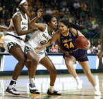 Baylor center Kalani Brown (21) and DiDi Richards, center, defend against a drive to the basket by California guard Recee' Caldwell (24) in the first half of a second-round game in the NCAA women's college basketball tournament in Waco, Texas, Monday, March 25, 2019. (AP Photo/Tony Gutierrez)