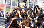 Red Bull driver Max Verstappen of the Netherlands celebrates with his team after winning the Austrian Formula One Grand Prix at the Red Bull Ring racetrack in Spielberg, southern Austria, Sunday, June 30, 2019. (AP Photo/Ronald Zak)
